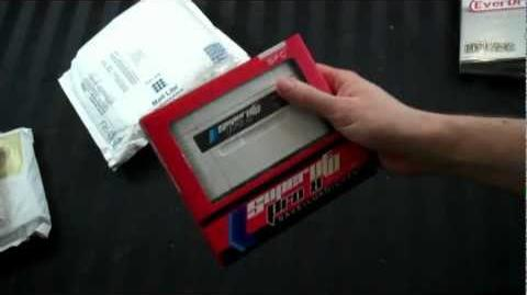 Gamerade - Super UFO Pro 8 Super Nintendo Famicom Flash Card - Adam Koralik