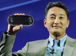 Kazuo Hirai with Playstation Vita