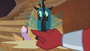 Tirek pointing at Chrysalis' log of wood S9E8