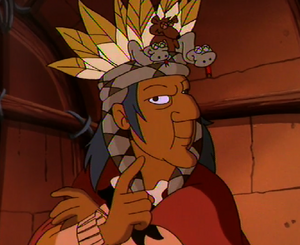 The Medicine Man admiring his headdress