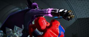 Prowler about to hit Spider-Man into the machine