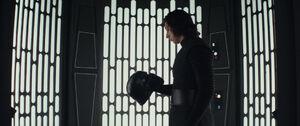 Kylo looking at his helmet