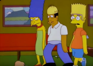 Burns in Marge's clothes