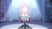 Lil gideon sitting in chair