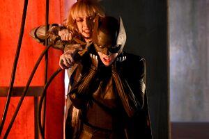 Alice strangles Batwoman