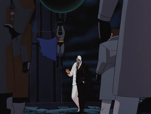 Batman held captive by Two-Face