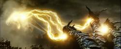 Keizer Ghidorah levitates Godzilla with its gravity beams