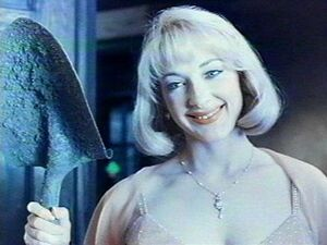 Debbie Jellinsky with a shovel