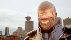 The Anti-Monitor's eyes and mouth glow
