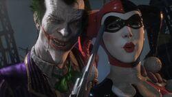 Joker holding Harley Quinn hostage