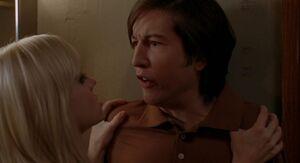 Samantha interrogating Mike