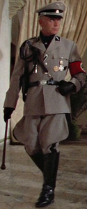The stiff leather gloved and swagger sticked German Standartenführer marches with a strict, enraged and evil stare