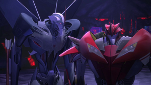 Starscream looks at Knock Out