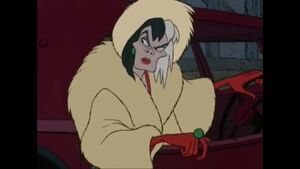 Cruella looking at the disguised puppies