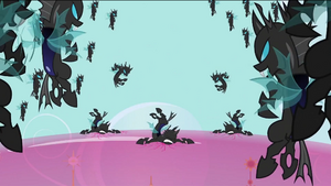 The changelings breaking Shining Armor's shield over Canterlot