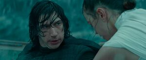 Kylo looking at Rey while being healed