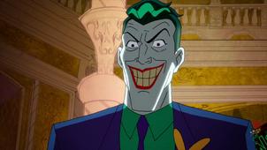 Joker smiles before killing Scarecrow