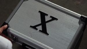 X suitcase