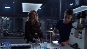 Eve helping Lena find a cure