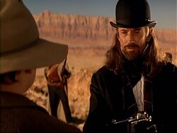 J.P. Stiles holding a gun