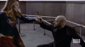 Lex blocks Supergirl's punch