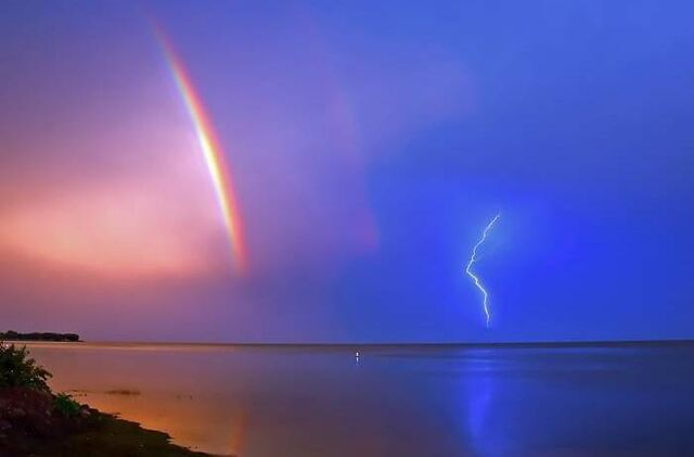 File:Rainbow with a Lightning Storm.jpg