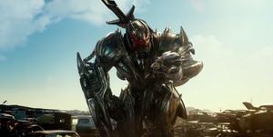 Megatron Grabs Starscream Head
