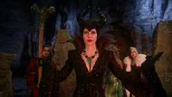 Maleficent controlling fire.