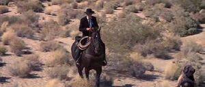 Reverend Kane on a horse