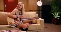 Samantha with her guitar