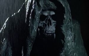 Cemetery-man-grim-reaper
