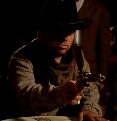 Grimm Jim aiming his gun