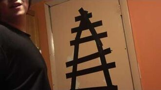 William uses double sticky tape to tape his door together