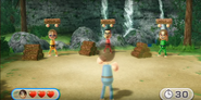 Siobhan, Shouta, and Ashley participating in Lumber Whacks in Wii Party