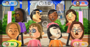 Jackie, Shouta, Sakura, Fumiko, Mia, Siobhan, Marisa, and Helen participating in Timber Topple in Wii Party.png