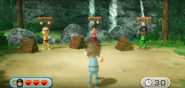 Barbara, Luca, and Ai participating in Lumber Whacks in Wii Party