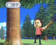 Shinta participating in Timber Topple in Wii Party