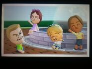 Tyrone, Giovanna, Megan, and Mia smiling at the fountain