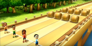 Maria, Shouta, and Helen participating in Flap Hurdles in Wii Party