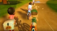 Patrick (left) carrying Pizza on his bike in Cycling