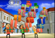 Keiko, Kentaro, and Gabi participating in Shifty Gifts in Wii Party