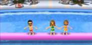 Shouta, Ashley, and Siobhan participating in Splash Bash in Wii Party
