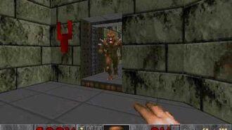 Diablillo atascado en una puerta abierta en Doom
