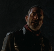 Negan looking at his victim S6E16