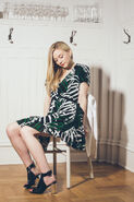 Emily Kinney sleeping beauty in a chair so cute