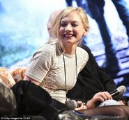 Emily enjoying a laugh on panel