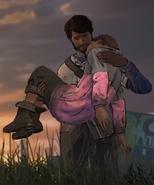 Javier holding Mariana's body
