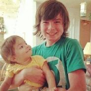 Chandler Riggs (Carl) with Eliza Cornwell (Judith) according to Chandler Riggs' twitter account.