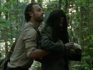 Rick inspects Clara for weapons