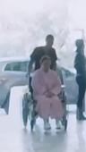 Wheelchair lady and nurse